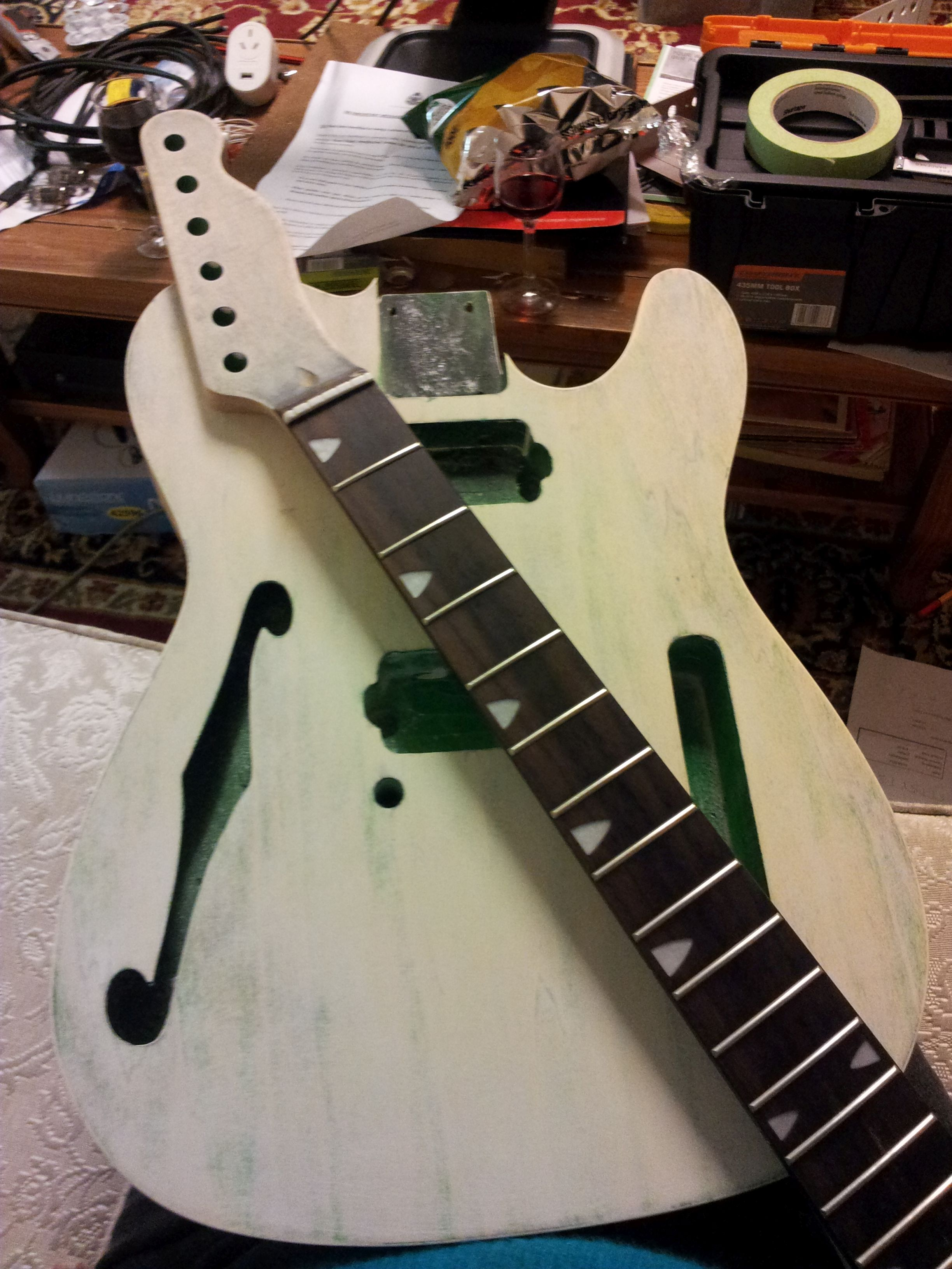 Second and third are with a coat of white primer When this dried I sanded back the neck to 800 and gave it and the fretboard an oil had to remove black